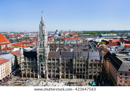 Main facade of the New Town Hall (Neues Rathaus) building by Georg von Hauberrisser, People in Marienplatz on the the famous Town Hall - stock photo