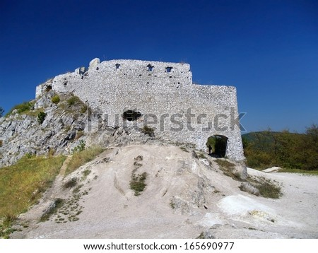 Main gate and massive fortification walls of Cachtice Castle, Slovakia. This castle was residence and later the prison of the world famous Elizabeth Batory. - stock photo
