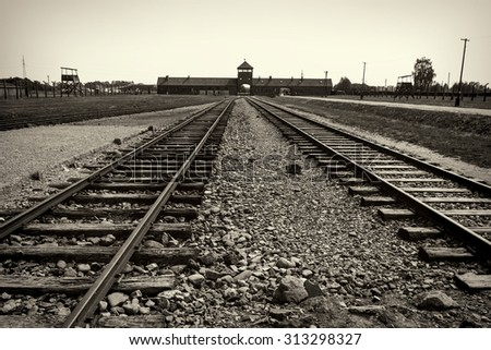 Main gate and railroad to nazi concentration camp of Auschwitz Birkenau - stock photo