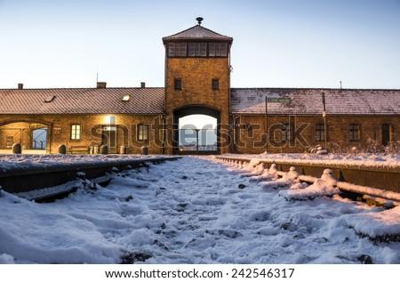 Main gate to nazi concentration camp of Auschwitz Birkenau, Poland - stock photo