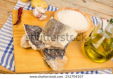Main ingredients to cook a traditional Mediterranean cod stew - stock photo