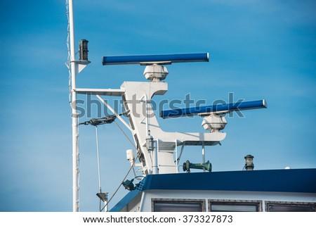 Main mast of passenger ship with navigation equipment - stock photo