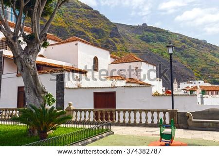 Main square in Garachico with monastery of San Francisco, Tenerife, Spain - stock photo