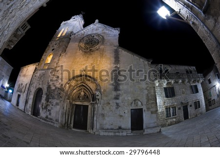 Main square with cathedral in old medieval town Korcula  by night. Croatia, Europe. Fish eye lens shot. - stock photo