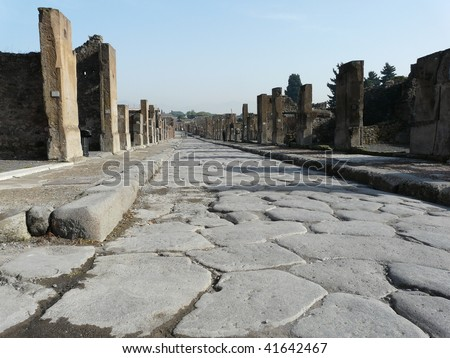 Main street at the ancient Roman city of Pompeii, which was destroyed and buried by ash during the eruption of Mount Vesuvius in 79 AD - stock photo