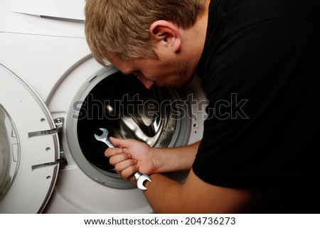 maintenance a washing machine - stock photo