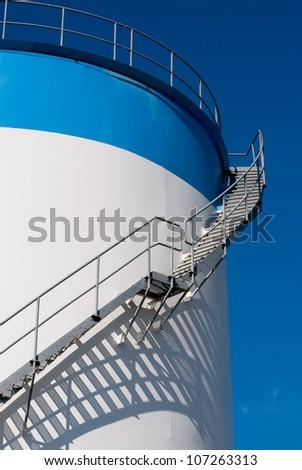 maintenance ladder on a oil storage tank - stock photo