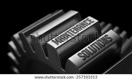 Maintenance Solutions on the Metal Gears on Black Background.  - stock photo