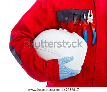 Maintenance technician in workwear holding his protective helmet. - stock photo