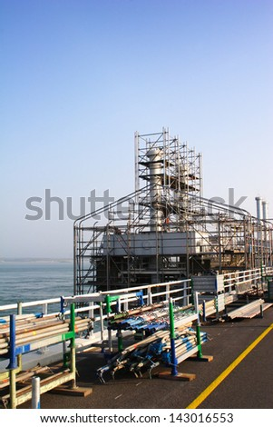 Maintenance work being done on the Dutch high sea level protection barrier at Oosterschelde (the Eastern Schelde). - stock photo