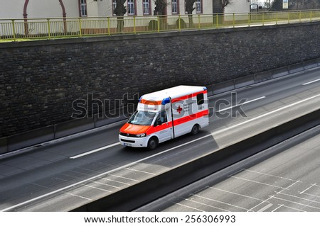 MAINZ, GERMANY - FEB 20: DEUTSCHES ROTES KREUZ van on the highway on February 20, 2015 in Mainz, Germany. The German Red Cross is the National Society of the International Red Cross in Germany. - stock photo