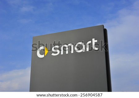 MAINZ,GERMANY-FEB 20:Smart Cars logo on February 20,2015 in Mainz, Germany.Smart Automobile is a division of Daimler AG that manufactures and markets the Smart Fortwo. - stock photo