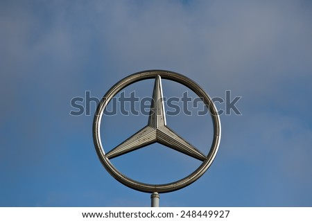MAINZ,GERMANY-JAN 30:Mercedes-Benz logo in the blue sky on January 30,2015 in Mainz,Germany.Is a German luxury automobile manufacturer, a multinational division of the German manufacturer Daimler AG - stock photo