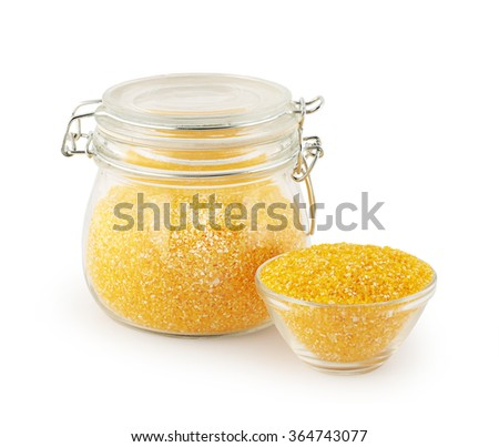 maize grits in glass kitchen utensils - stock photo