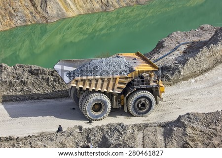MAJDANPEK, SERBIA - MAY 01, 2015: Dumper in open pit Majdanpek were the first reserves of copper ore found at  1953. Open pit mine is still working. - stock photo