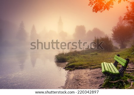 Majestic colorful foggy morning on the lake in Triglav national park, located in the Bohinj Valley of the Julian Alps. Dramatic view. Instagram effect, retro filter. Slovenia, Europe. Beauty world. - stock photo