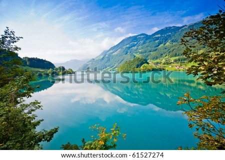 Majestic emerald mountain lake in Switzerland - stock photo