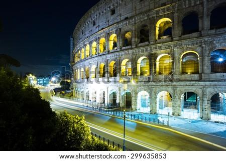 Majestic evening Coliseum or Amphitheatrum Flavium with bright illumination on blue sky background, Rome, Italy - stock photo