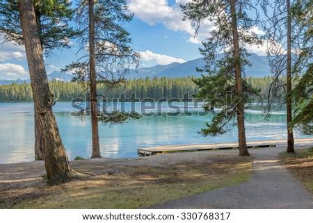 Majestic mountain lake in Canada. Anette Lake view in Jasper, Alberta, Canada. Rocky Mountains. - stock photo