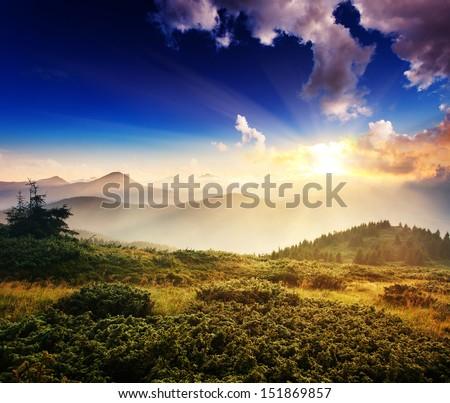 Majestic mountain landscape with colorful cloud. Dramatic overcast sky. Carpathian, Ukraine, Europe. Beauty world. - stock photo