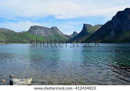 majestic mountain peaks and blue fjord landscape senja island summertime - stock photo