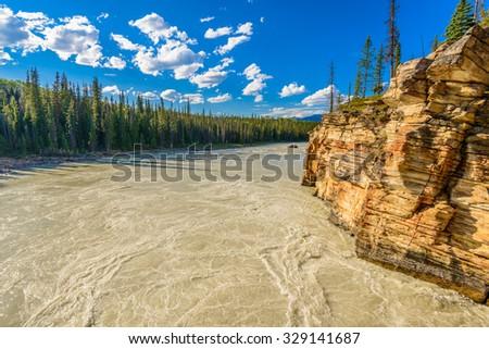 Majestic mountain river in Canada. Athabasca River, Banff, Alberta. - stock photo