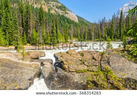 Majestic mountain river in Canada. Athabaska Falls in Alberta, Canada. - stock photo