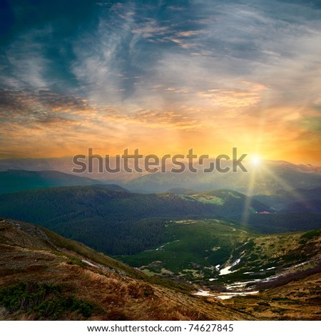 majestic mountain sunset and colored sky with clouds - stock photo
