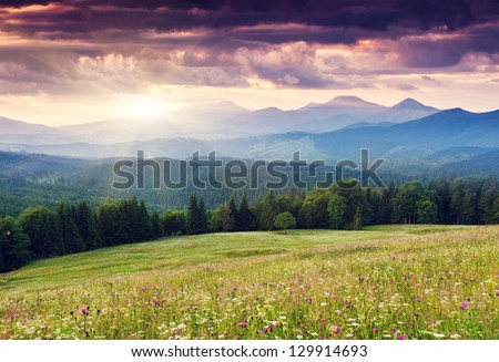 Majestic mountains landscape under morning sky with clouds. Overcast sky before storm. Carpathian, Ukraine, Europe. - stock photo