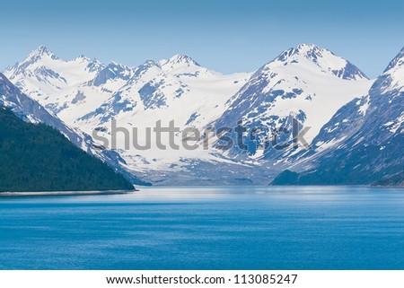 Majestic mountains surround the famous Glacier Bay National Park in Alaska - stock photo