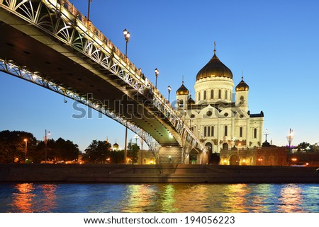 Majestic orthodox Cathedral of Christ Saviour illuminated at dusk on bank of Moscow river, Moscow, Russia. It is tallest Orthodox church in world. - stock photo