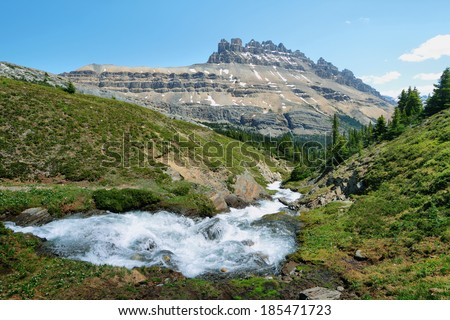 Majestic peaks and stream in Helen lake trail, banff national park - stock photo