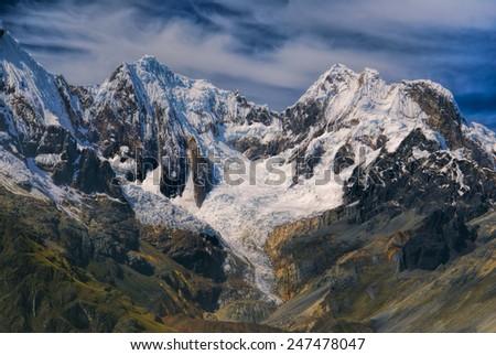Majestic peaks around Alpamayo, one of highest mountain peaks in Peruvian Andes, Cordillera Blanca - stock photo