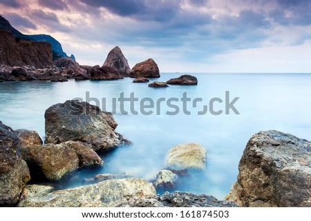 Majestic summer sunset over the sea. Dramatic overcast sky with colorful cloud. Crimea, Ukraine, Europe. Beauty world. - stock photo