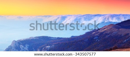 Majestic sunset in the foggy mountains landscape. - stock photo