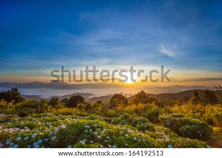 Majestic sunset in the mountains landscape. Dramatic sky. Huay Nam Dang, Chiang Mai, Thailand - stock photo