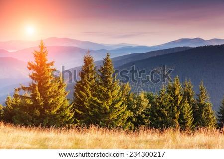 Majestic sunset in the mountains landscape with sunny beams. Dramatic scene. Carpathian, Ukraine, Europe. Beauty world. Retro style, vintage filter. Instagram toning effect. - stock photo