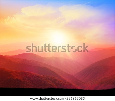 Majestic sunset in the mountains landscape with sunny beams. Dramatic scene. Carpathian, Ukraine, Europe.Colorful sky. - stock photo