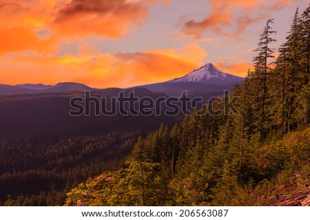 Majestic Sunset View of Mt. Hood with dramatic skies during the summer months. - stock photo