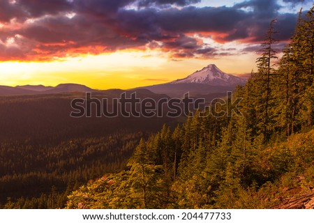 Majestic Sunset View of Mt. Hood with drmatic skies during the summer months. - stock photo