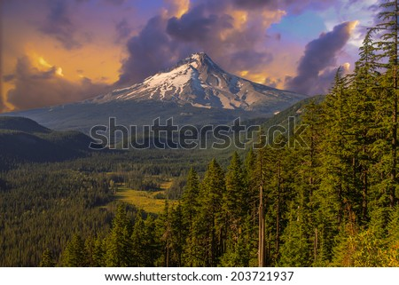 Majestic View of Mt. Hood. Sunset scene with dramatic sky. - stock photo