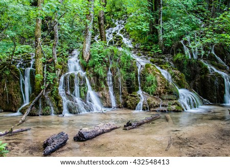 Majestic view of waterfall with crystal clear water in forest in The Plitvice Lakes National Park in Croatia Europe.  - stock photo