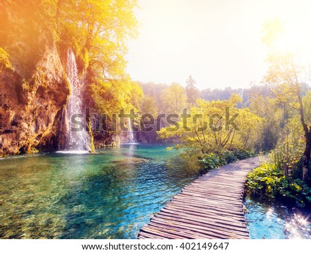 Majestic view on  lake and sunny beams in the Plitvice Lakes National Park. Croatia. Europe. Dramatic scene. Beauty world. Cross processed retro and vintage style. Instagram toning effect. Soft filter - stock photo