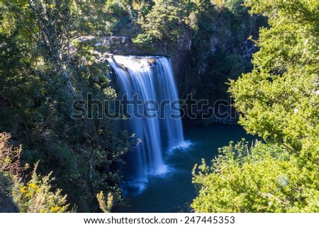 Majestic waterfall in the forest of Whangarei region, New Zealand Northern Island. Blurred motion, frontal view. - stock photo