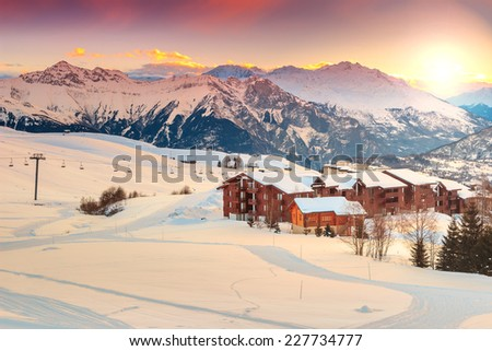 Majestic winter sunrise landscape and ski resort in French Alps,La Toussuire,France,Europe - stock photo