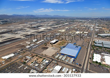 Major Airport viewed from above a swap meet site, former home to dog racing in Phoenix, Arizona - stock photo