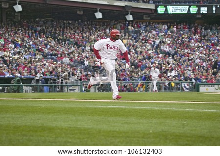 Major League baseball player for the Philadelphia Phillies, #6, slugger Ryan Howard, running to first base during March 31, 2008 opening game against Washington Nationals, at Citizens Bank Park - stock photo