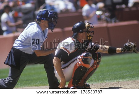 Major league catcher and umpire behind home plate - stock photo