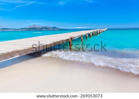 Majorca Platja de Muro beach pier in Alcudia bay in Mallorca Balearic islands of Spain - stock photo