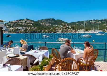 MAJORCA, SPAIN - JUNE 01: Tourists having lunch in Puerto de Andratx, one of the most important and exclusive landmarks in Majorca due to its nautical activity, on June 01, 2013 in Majorca, Spain  - stock photo